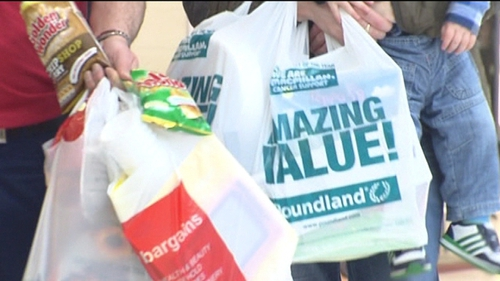 England's five pence charge per single-use bag is intended to reduce litter and protect wildlife.