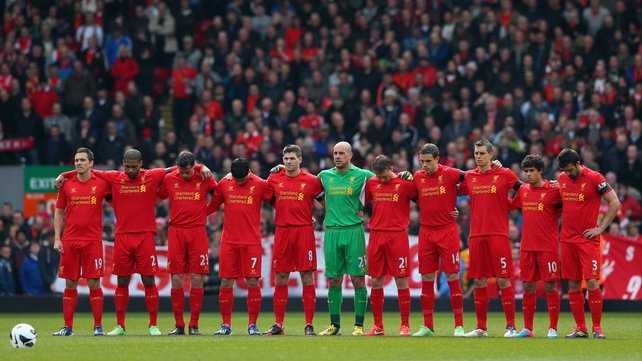 The Liverpool players observe a minute's silence for the victims of the Hillsborough