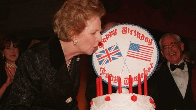 Mrs Thatcher blows out the candles on her birthday cake at a celebration marking her 70th birthday in Washington in 1995