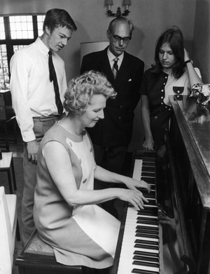 The then Secretary of State for Education and Science Margaret Thatcher plays the piano for husband Denis and their 17 year-old twins Mark and Carol