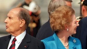French President Frantois Mitterrand and British Prime Minister Margaret Thatcher look different ways while posing in front of the Louvre Pyramid in Paris in 1989