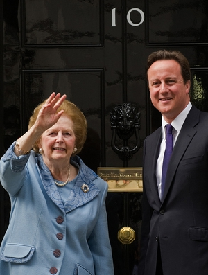 Baroness Thatcher waves to photographers as she stands with David Cameron outside 10 Downing Street in 2010