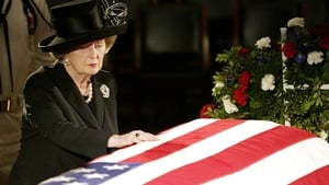 Mrs Thatcher reaches out to touch the flag draped coffin of former President Ronald Reagan as he lies in state in 2004