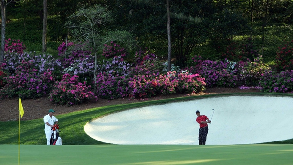 Tiger Woods hits his third shot on the 13th hole during the final round of the 2005 Masters