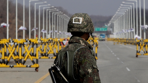 A South Korean soldier stands guard at the border with the North