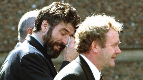 Gerry Adams and Martin McGuinness show the strain of negotiations after agreement was finally reached, 17 hours after the midnight deadline