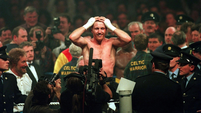 Stephen Collins celebrates after beating Chris Eubank in 1995