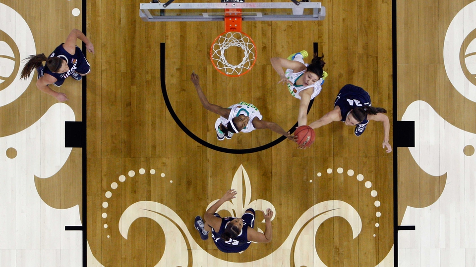 The Notre Dame Fighting Irish play the Connecticut Huskies in the Women's Basketball Championship at the New Orleans Arena