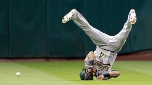 Coco Crisp of the Oakland Athletics comes up short on a sinking line drive at Minute Maid Park in Houston, Texas