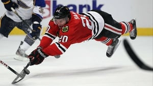 Brandon Saad of the Chicago Blackhawks dives for the puck against the St. Louis Blues at the United Center, Chicago