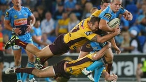 Greg Bird of the Titans is double-tackled during the NRL match between the Gold Coast Titans and Brisbane Broncos at Skilled Park