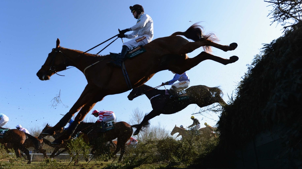 Horses clear the infamous Becher's Brook at the Aintree Grand National