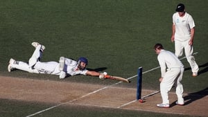 Monty Panesar of England dives into his crease ahead of the ball against New Zealand at Eden Park, Auckland