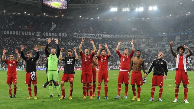 Bayern Munich salute their travelling fans after the victory in Turin