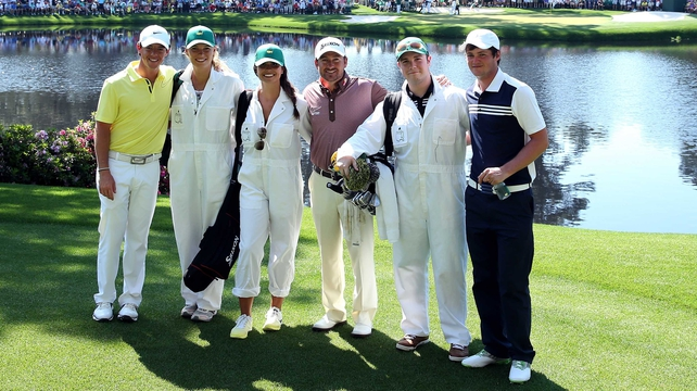 Rory McIlroy, Graeme McDowell and Alan Dunbar with their respective caddies at the par three event