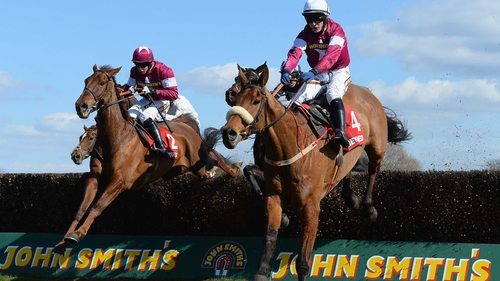 First Lieutenant (l) and Quito De La Roque jumping the last in the Betfred Bowl at Aintree