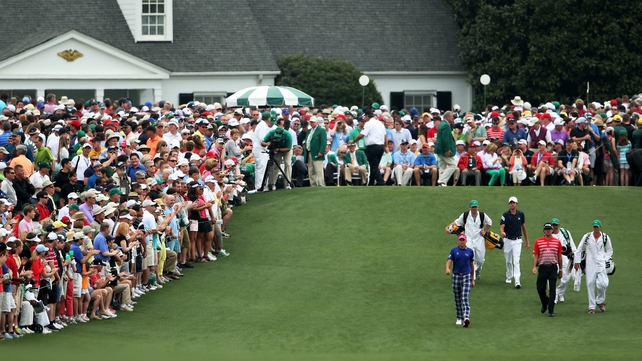 Ian Poulter, Bubba Watson and Steven Fox  walk up the fairway on the first hole