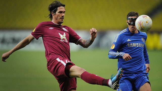Masked man Fernando Torres (right) was on target for the Blues in Moscow