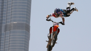 A motocross rider shows his skills during a training session outside Burj Khalifa on the eve of the 2013 Red Bull X-Fighters World Tour in the Gulf emirate of Dubai