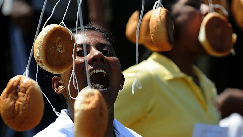 A Sri Lankan participant tries to bite a bun tied on a string during traditional Sinhala and Tamil New Year celebrations in Colombo. The New Year dawns on 14 April and traditional fun and games are organised across the island to celebrate the occasion.