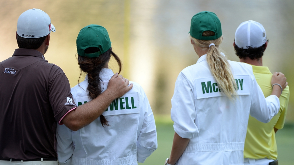 Rory McIlroy of Northern Ireland hugs his caddie Caroline Wozniacki as Graeme McDowell of Northern Ireland hugs his caddie and fiance Kristin Stape