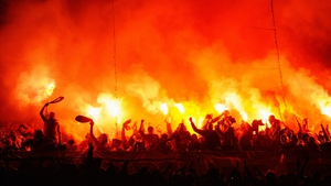 Galatasaray fans light flares during the UEFA Champions League Quarter Final first leg match between Real Madrid and Galatasaray at Estadio Santiago Bernabeu