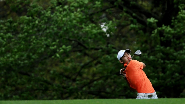 Guan Tianlang hits his tee shot on the fourth hole during the second round of the Masters