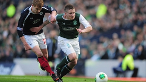 Jay Fulton of Falkirk battles with Paul Cairney of Hibernian