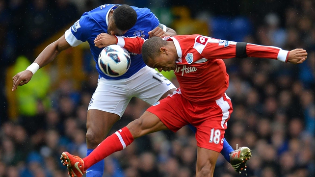 Queens Park Rangers' French striker Loic Remy (r) heads the ball with Everton's French defender Sylvain Distin