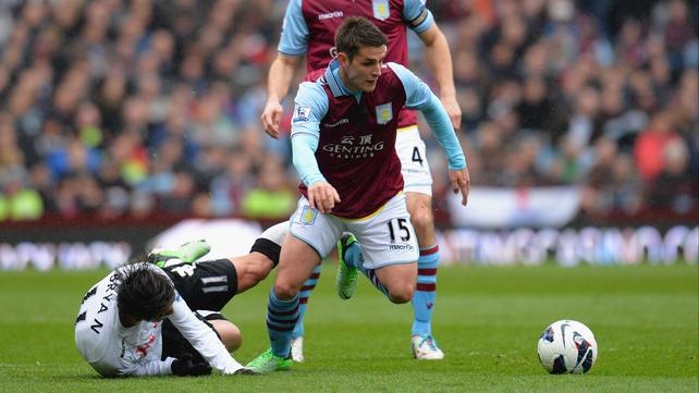 Ashley Westwood of Aston Villa breaks away from Bryan Ruiz of Fulham