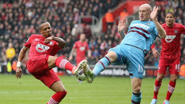 James Collins of West Ham challenges Nathaniel Clyne of Southampton