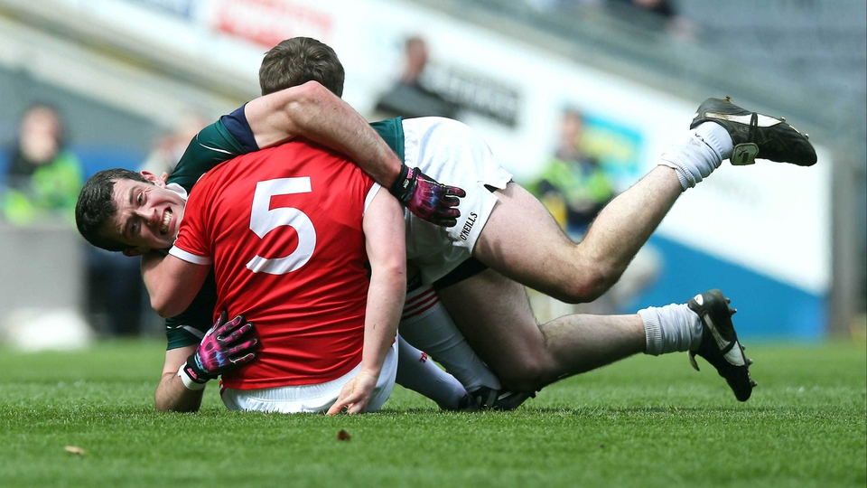 Padraig O'Neill of Kildare and Tyrone's Dermot Carlin take a roll and tumble on the turf at Headquarters