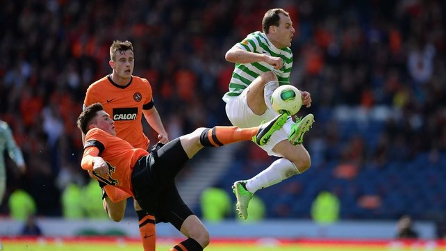 Anthony Stokes of Celtic battles with Mark Millar of Dundee United