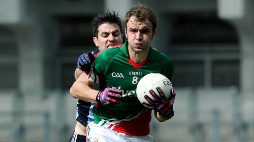 Dublin's Michael Darragh MacAuley and Mayo's Jason Gibbons
