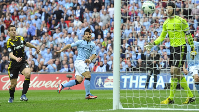 Sergio Aguero watches his header pass Petr Cech in the Chelsea goal