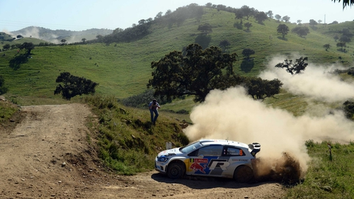 Sebastien Ogier guides his Volkswagen Polo R over the rustic roads of Faro