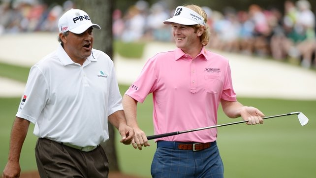Leaders Brandt Snedeker and Angel Cabrera having a chat during their final round at Augusta