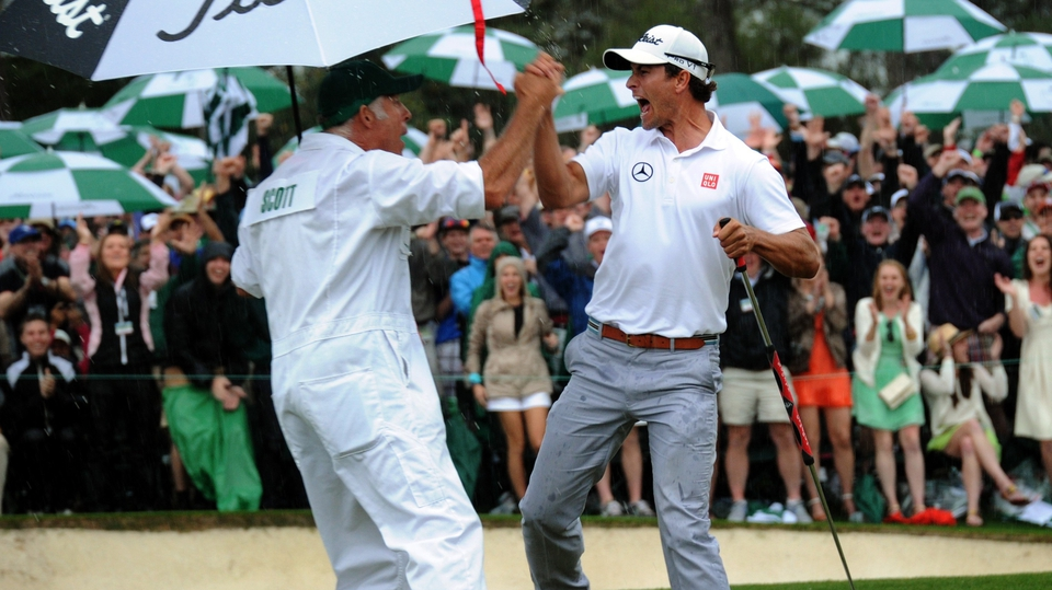 Adam Scott celebrates with caddie Steve Williams en route to securing his maiden major and the Green Jacket at The Masters