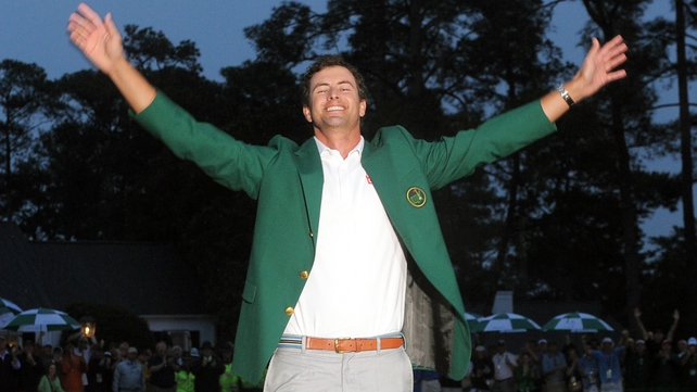 Adam Scott was presented with his Green Jacket from last year's champion Bubba Watson