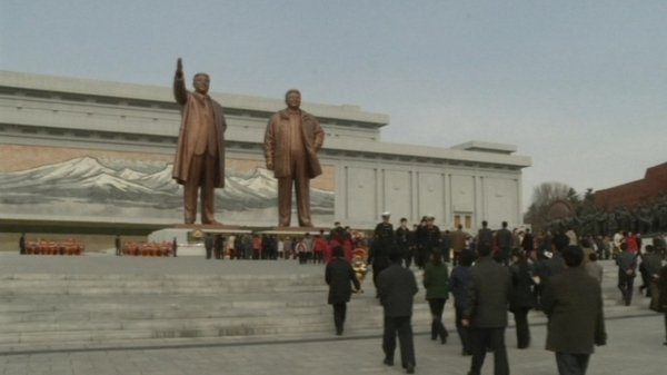 People visited giant statues of Kim Il sung and Kim Jong Il