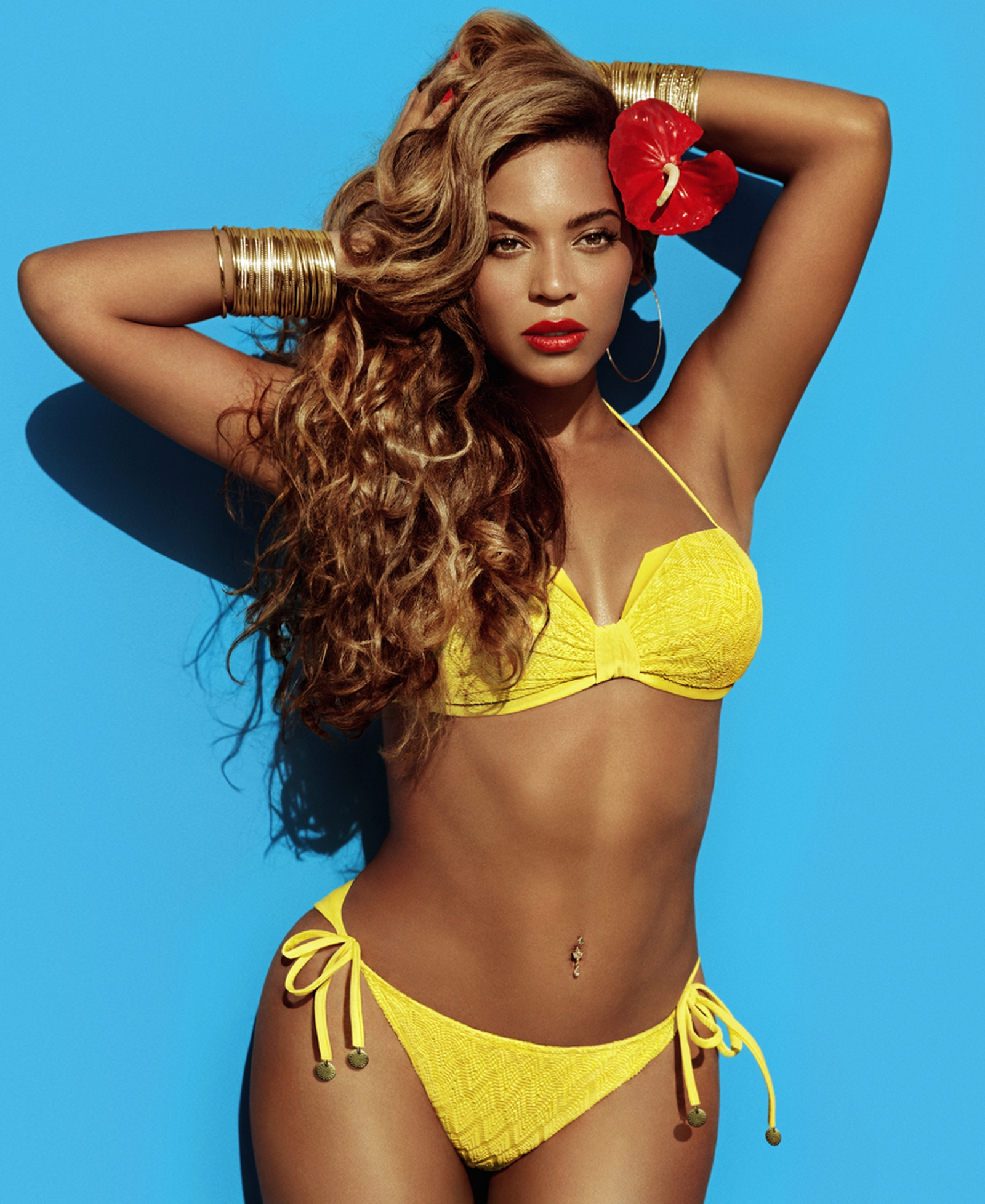 Beyoncé Sizzles In New HM Swimwear Photos