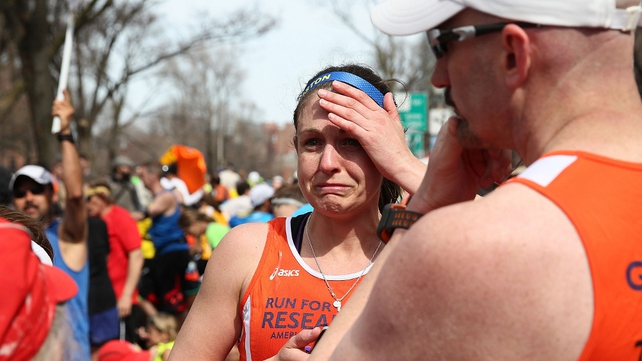 A distressed runner at the finish line of Boston Marathon