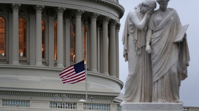 The US flag flies at half-mast over the Capitol in Washington