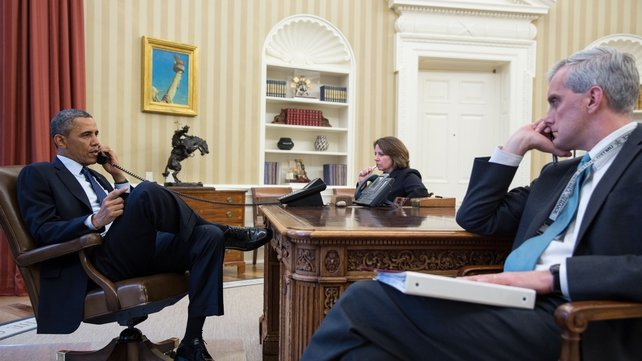 US President Barack Obama is briefed on the situation by FBI Director Robert Mueller