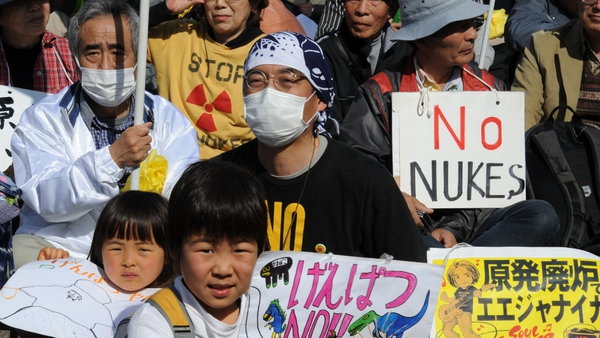 Anti-nuclear protesters hold placards at an anti-nuclear rally in Tokyo in March