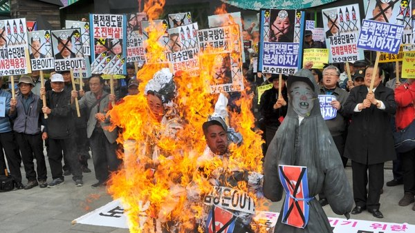 South Koreans burned effigies during a protest in Seoul yesterday