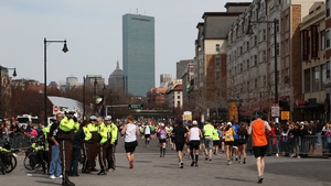Marathon runners disperse after the blasts