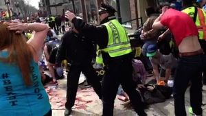 A video screengrab shows a bloodied street in Boston
