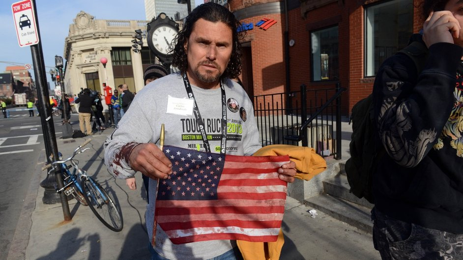 Carlos Arredondo, who was at the finish line of the 117th Boston Marathon when two explosives detonated, leaves the scene