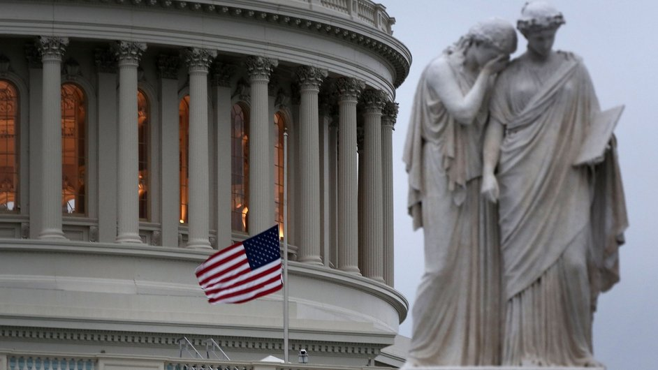 A US flag flies at half mast on the US Capitol in Washington DC